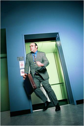 Business executive escaping from a sales elevator pitch.