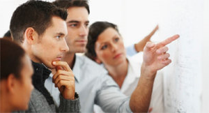 Picture of business people discussing a sales issues. Illustrates our sales consultant services page.