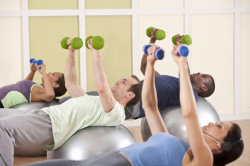 Picture of people exercising in a gym to illustrate an article about sales training exercises.